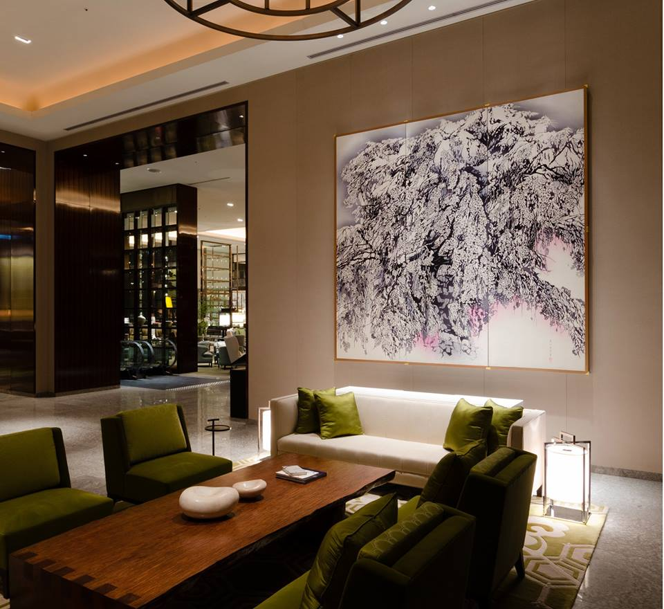 """Early Morning"" by Mika Toba, welcomes our guests in the Main Lobby. Created using the traditional Japanese dying method 'katazome', the painting shows various expressions with the change of light through the day. Come see our beautiful cherry blossoms at Palace Hotel Tokyo."