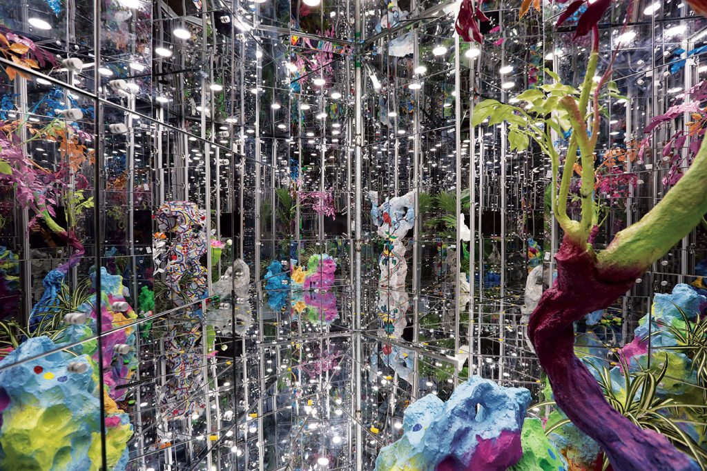 Deng Guoyuan, Noah's Garden II. (2016), Aluminium alloy steel frame, mirror glass. LED lighting. real and artificial plants and rocks, 1160 x 650 x 320 cm, Collection of the Artist, Singapore Biennale 2016 commission, Source: Singapore Biennale Exhibition Guide